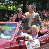 Canastota's welterweight champ Billy Backus enjoys the parade with his family.