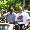 Parade route puts a smile on the faces of Daniel Jacobs and his trainer Andre Rozier.