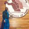 Spinks poses by the Hall of Fame logo.