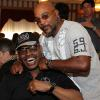 "Spinks and ""Buddy"" McGirt enjoy a playful moment during the 2012 Hall of Fame Weekend"