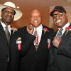 "Michael Spinks, ""Bonecrusher"" Smith and Leon Spinks gather for a photo at 2013 Hall of Fame Weekend."